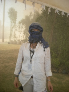 Things you learn for set can be very useful in unusual ways.  Here I am wrapped up to keep the paper & dust out of my lungs while shooting a sand storm in Dubai.