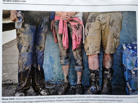 The mud is so fabulous.  Photo of volunteers, Magazine Maclean's